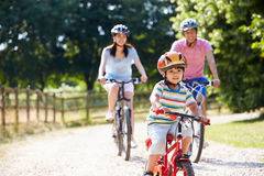 Asian Family On Cycle Ride In Countryside Stock Image