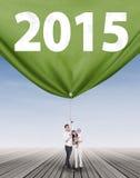 Asian family dragging number 2015 Stock Photos