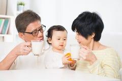 Asian family drinking milk Stock Image