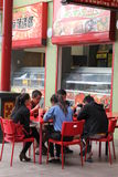 Asian couples are eating outdoor at a terrace in Chinatown, Adelaide, Australia Stock Photos
