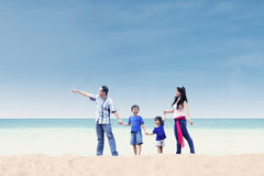 Asian family enjoy holiday at beach. Asian family enjoying their holiday at white sand beach Royalty Free Stock Photos