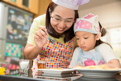 Asian family enjoy making pancake, Asian mother and daughter enjoy making bakery. Cake, Little Asian girl and mom enjoy decorate cake in real life kitchen,Asian Stock Image