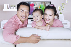 Asian family enjoy their leisure time. Portrait of asian family enjoy their leisure time while sitting on sofa in the living room Stock Images