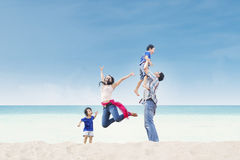 Asian family enjoy time at beach. Asian family having fun at the beach Royalty Free Stock Photo