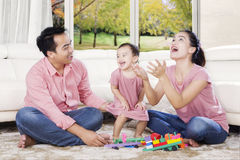Asian family enjoying leisure time together at home Stock Photo