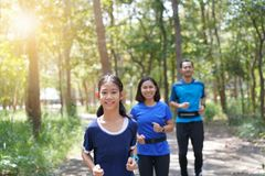 Family exercising and jogging together at the park royalty free stock photography