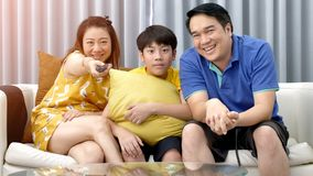 Asian family father mother and son on couch stock photography
