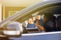 Asian family of father, mother and son waving goodbye to grandfather and grandmother as they take off their journey. Asian family of father, mother and son Royalty Free Stock Photos
