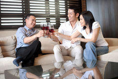 Asian family friend with wine Stock Images