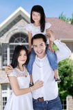 Asian family in front of new house Stock Photo