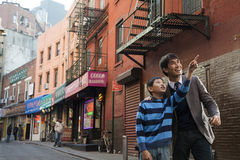 Asian family in front of store Stock Photos