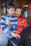 Asian family in front of store Royalty Free Stock Photography