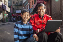 Asian family in front of store Stock Image