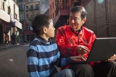 Asian family in front of store. In Chinatown Royalty Free Stock Photos