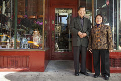 Asian family in front of store Royalty Free Stock Images