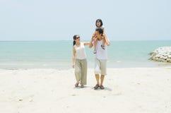 Asian family. Happy Asian family at the beach royalty free stock photo