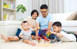 Asian family. Happy Asian family playing toys stock photos