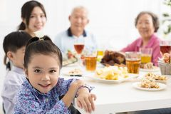 Asian family having dinner at home. Happy asian family having dinner at home Royalty Free Stock Images