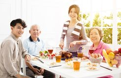 Asian family having dinner at home. Happy asian family having dinner at home Royalty Free Stock Image