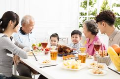 Asian family having dinner at home. Happy asian family having dinner at home Stock Image