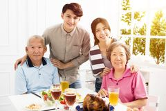 Asian family having dinner together. Happy asian family having dinner together Royalty Free Stock Photo