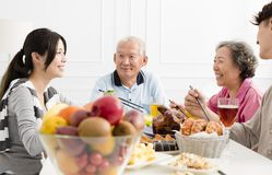 Asian family having dinner together. Happy asian family having dinner together Royalty Free Stock Photography