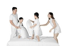 Asian family having fun with pillows on studio Royalty Free Stock Photography