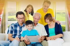 Asian family. Having fun with tablet computer Royalty Free Stock Photography