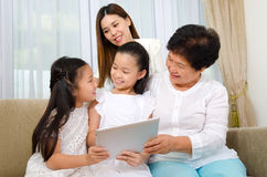Asian family. Having fun with tablet computer Royalty Free Stock Photo