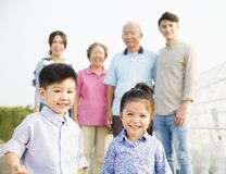 Asian family having fun together outdoors. Multi-generation family having fun together outdoors stock images