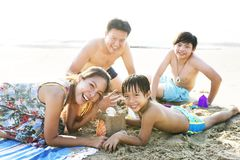 Asian family having good time at the beach royalty free stock images