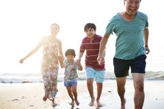 Asian family having a good time at the beach royalty free stock photo