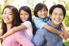 Asian family head and shoulders portrait outdoors Royalty Free Stock Photo
