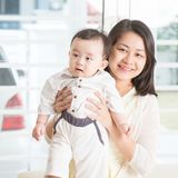 Mother holding baby son. Royalty Free Stock Image