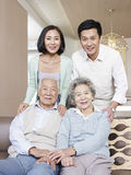 Asian family. Home portrait of a happy asian family stock photos