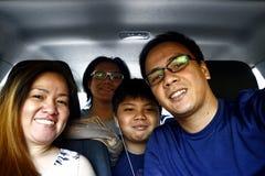 Asian family inside a car stock image