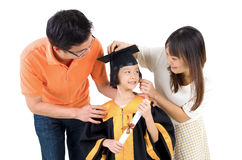 Asian family. Asian kid in graduation gown.Taking photo with family stock photos