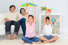 Asian family. Asian kids showing off their building blocks royalty free stock photos