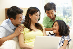 Asian family with laptop Stock Photos
