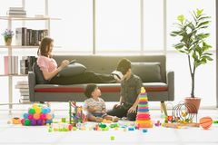 ASIAN FAMILY AT LEISURE stock photography