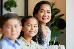 Asian family looking at camera stock image