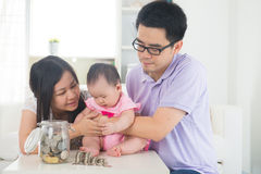 Asian family money saving concept Royalty Free Stock Image