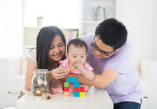 Asian family money saving concept Royalty Free Stock Photo