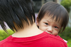 Asian Family in mother's arms.  Royalty Free Stock Photo