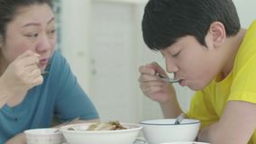 Asian family mother with son having lunch at home stock footage