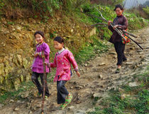 Asian family, mother and two daughters, sisters, on mountain tra Royalty Free Stock Image