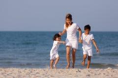 Asian Family On Beach Royalty Free Stock Image