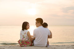 Asian family at outdoor beach Stock Image