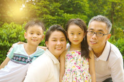 Asian family. Outdoor portrait of asian family Stock Images