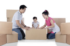 Asian family is packing cardboard on studio Royalty Free Stock Photo